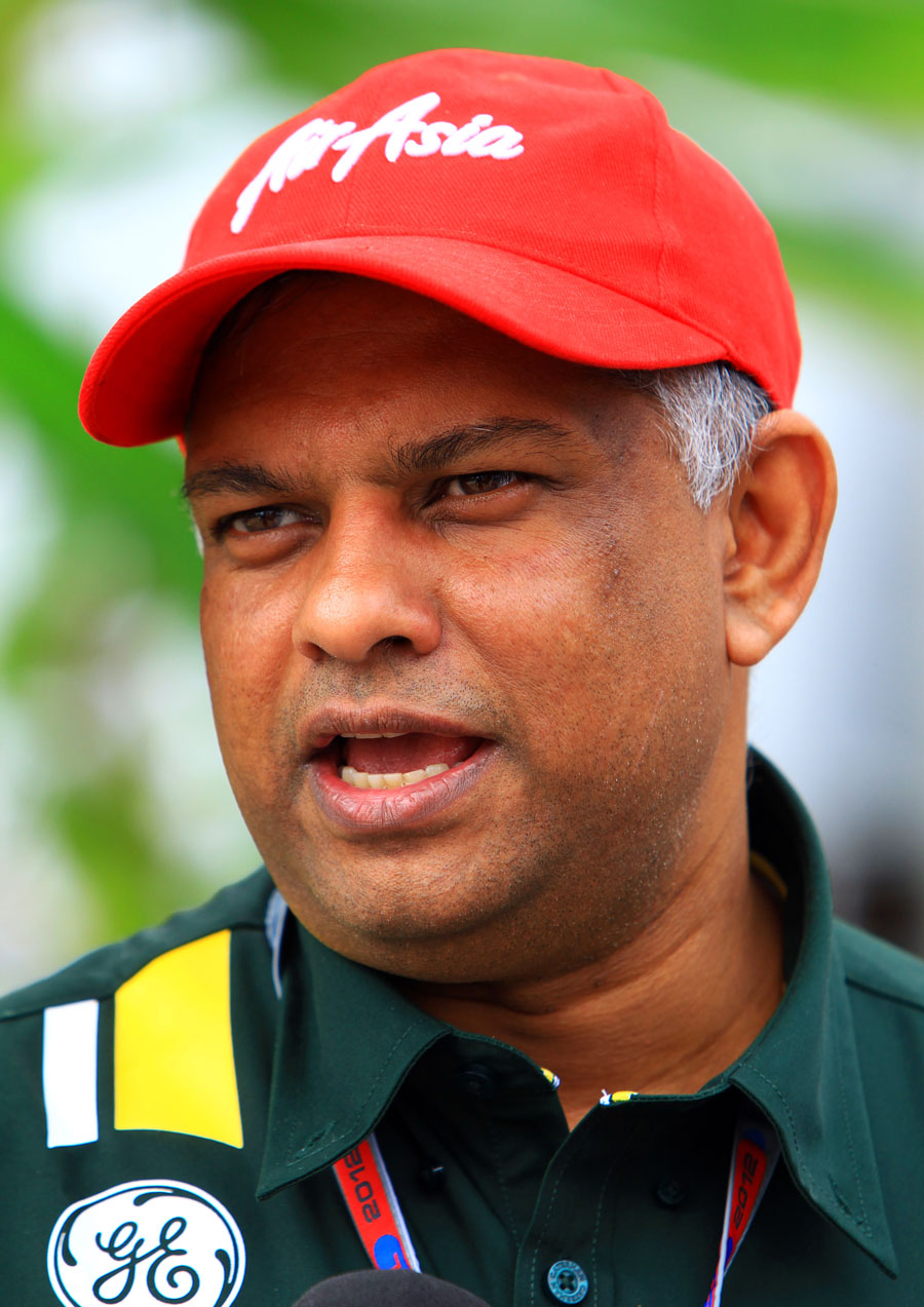 Tony Fernandes speaks to the press in the paddock on Saturday