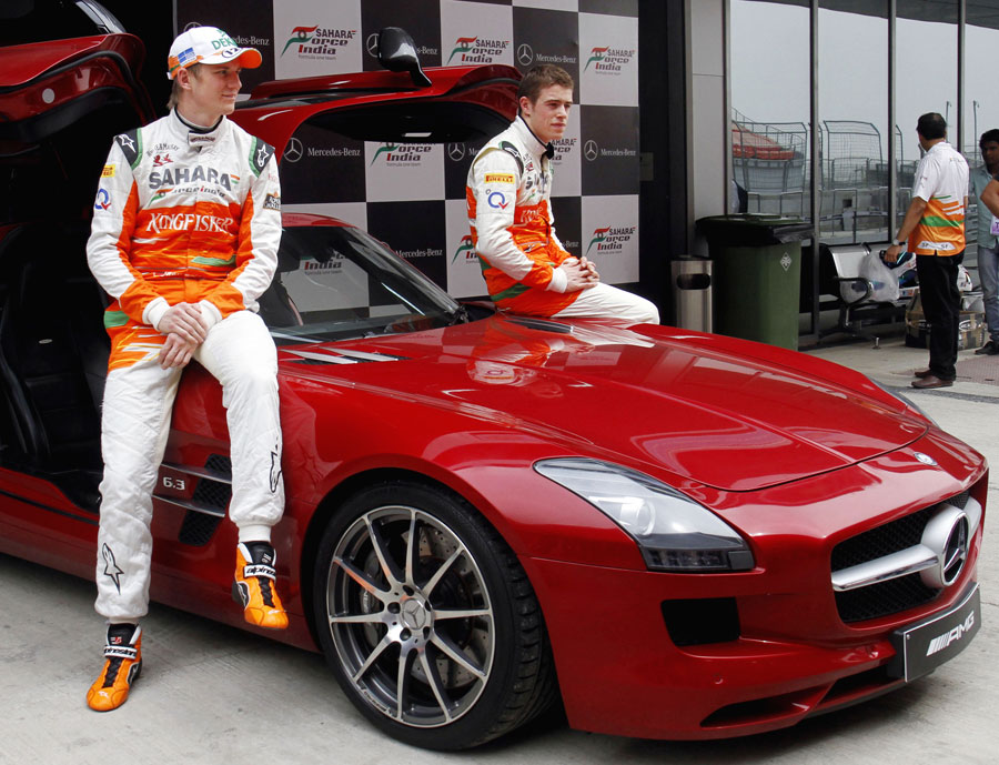 Force India drivers Nico Hulkenberg and Paul di Resta pose with a Mercedes SLS