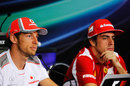 Jenson Button and Fernando Alonso respond to questions in the press conference