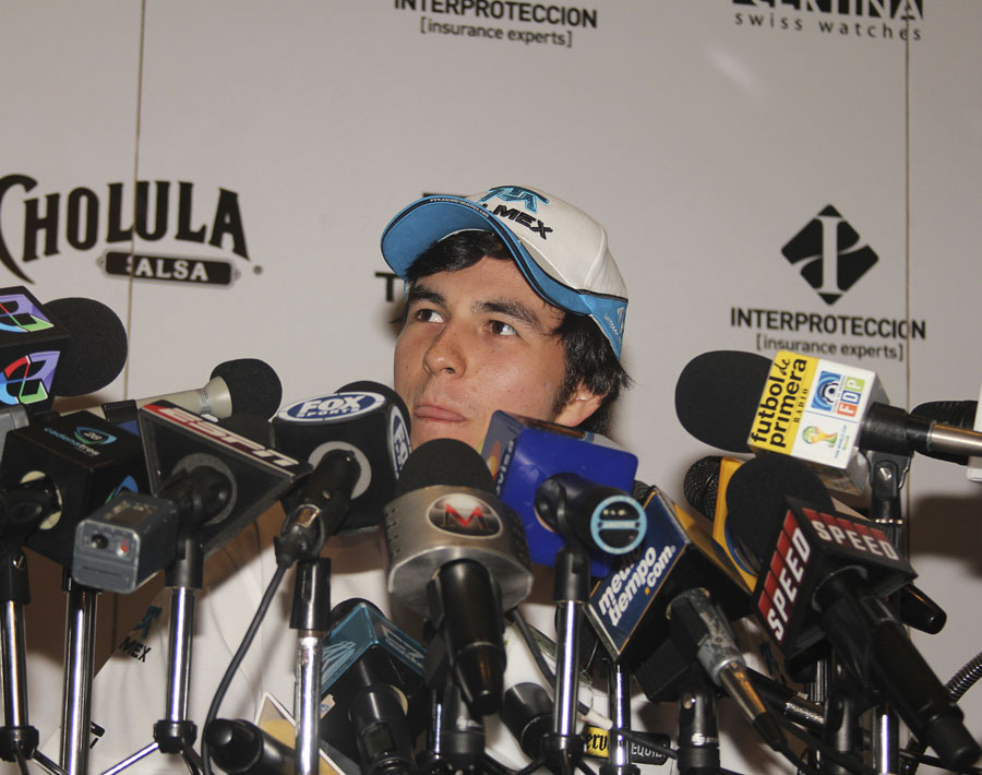 Sergio Perez talks to the press in his home town