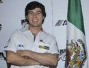 Sergio Perez poses for a photo at a press conference