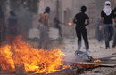 Bahraini anti-government protesters face off against riot police