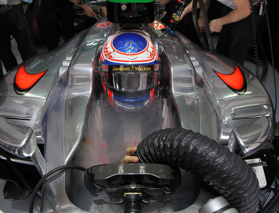Jenson Button keeps cool in the cockpit of his McLaren