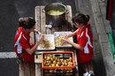 Ferrari catering staff peel potatoes in the paddock