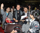 Micheal Schumacher is greeted by fans at the airport upon his arrival ahead of the Chinese Grand Prix