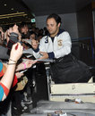 Felipe Massa signs autographs at the airport upon his arrival ahead of the Chinese Grand Prix