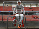 Nico Hulkenberg waits during a promotional event at the Buddh International Circuit
