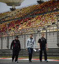 Sebastian Vettel walks the track with his support team on Thursday morning