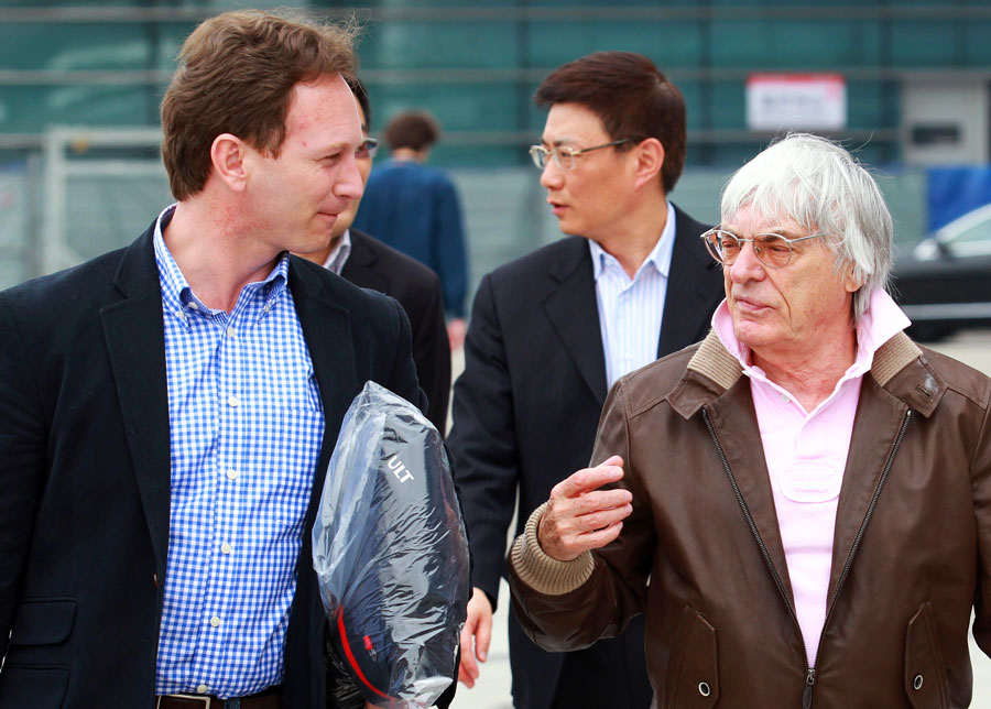 Bernie Ecclestone speaks to Christian Horner in the paddock