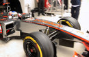 Jenson Button leaves the McLaren garage