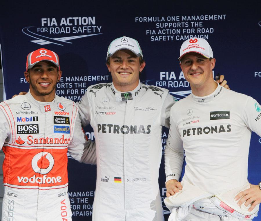 Nico Rosberg celebrates his maiden pole position with Lewis Hamilton and Michael Schumacher