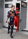 Sebastian Vettel and Felipe Massa leave the weigh-room after being eliminated in Q2