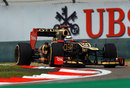 Kimi Raikkonen attacks the apex in his Lotus