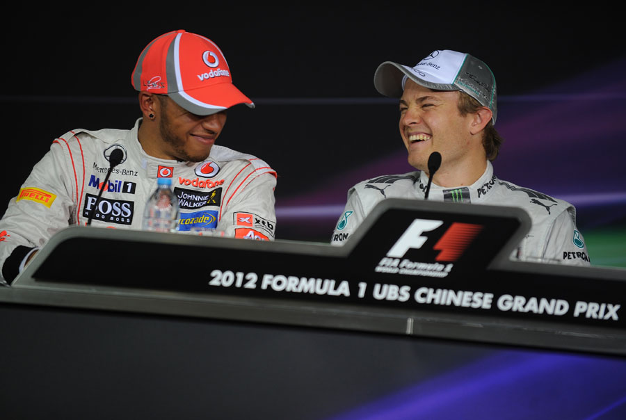 Lewis Hamilton and Nico Rosberg share a joke in the post-qualifying press conference