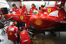Ferrari mechanics work on Felipe Massa's car