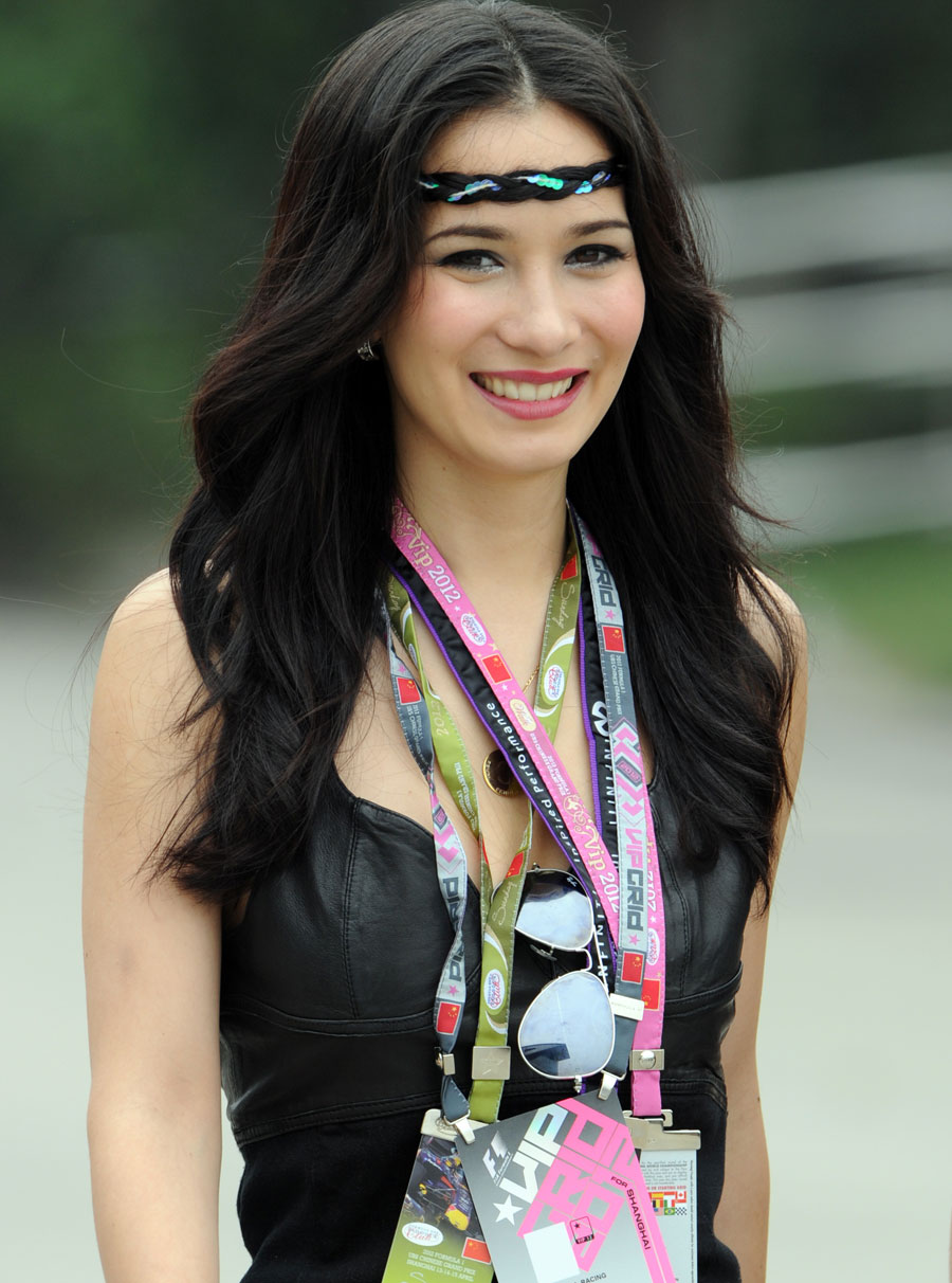 Actress Celina Jade walks in the paddock