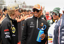 Kimi Raikkonen and Lewis Hamilton share a joke on the grid