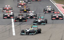 Nico Rosberg leads the pack into the first corner
