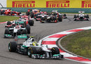 Nico Rosberg leads the pack through the first two corners