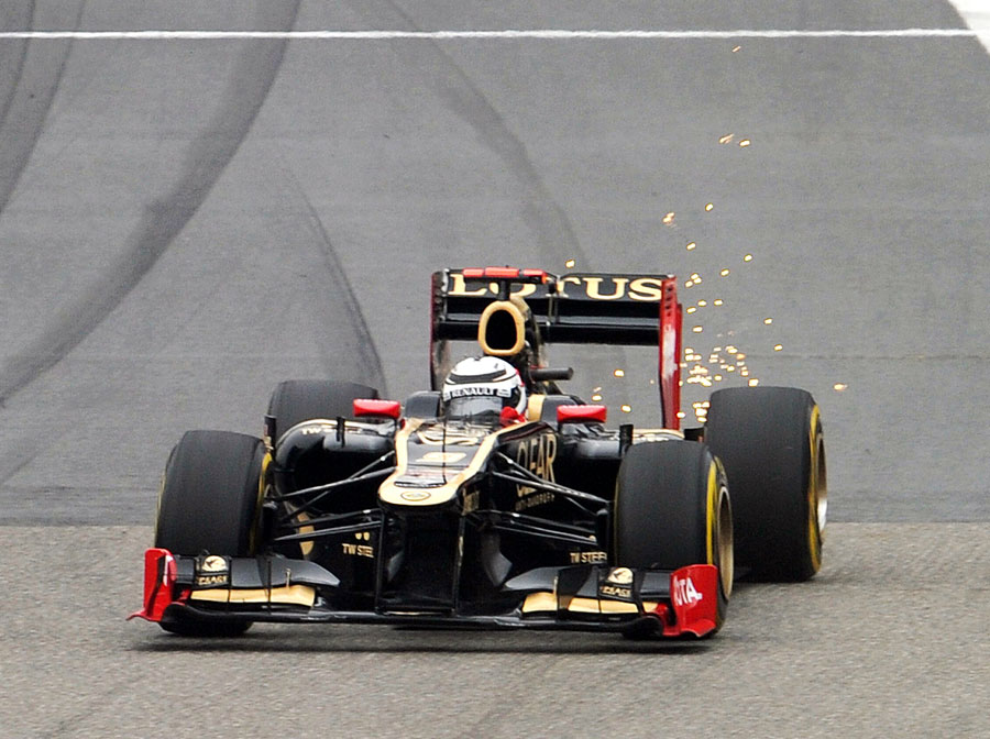 Sparks fly from the rear of Kimi Raikkonen's Lotus