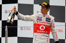 Jenson Button salutes his team on the podium