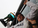 Nico Rosberg celebrates his first F1 victory with his mechanics