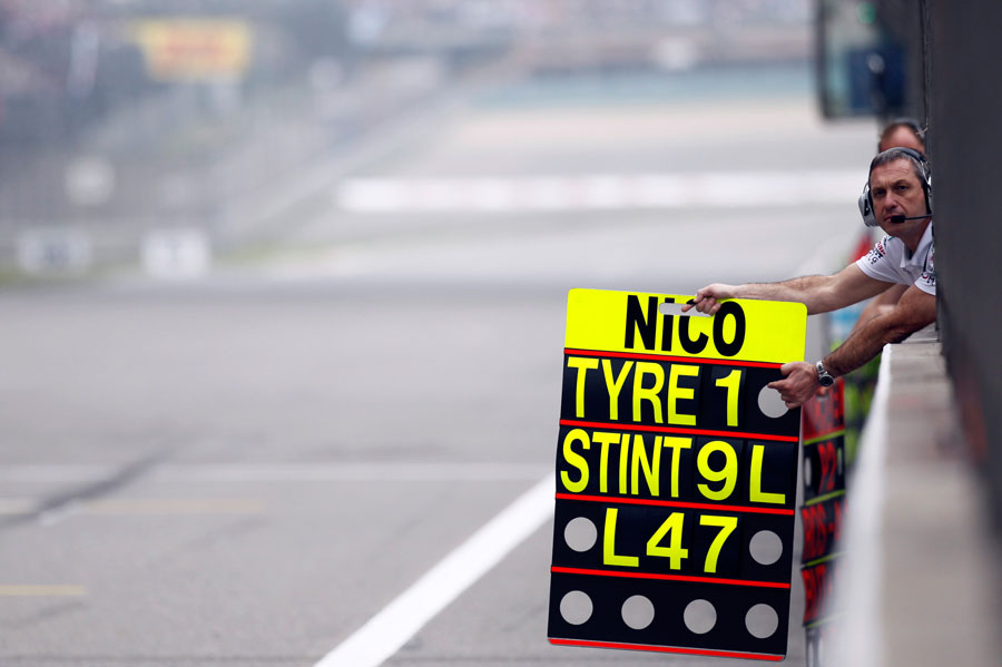A Mercedes mechanic holds out Nico Rosberg's pit board