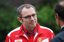 Stefano Domenicali listens intently in the paddock