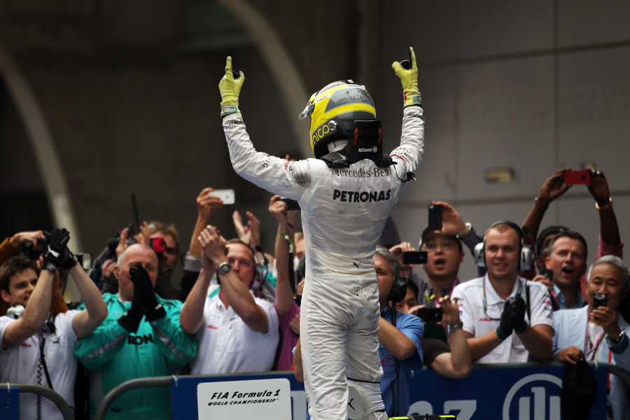 Nico Rosberg celebrates his first F1 victory with his team