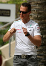 Michael Schumacher gets very expressive in the paddock on Thursday