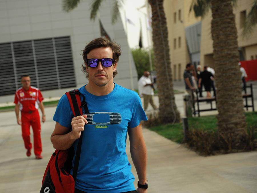 Fernando Alonso walks through the paddock