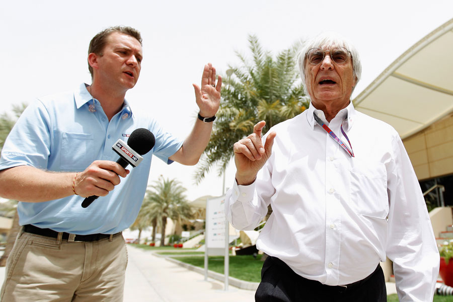 Bernie Ecclestone conducts a brief interview in the paddock