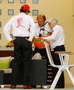 Force India deputy team principal Bob Fernley talks to Bernie Ecclestone and Bahrain International Circuit chairman Zayed Al-Zayani in the paddock