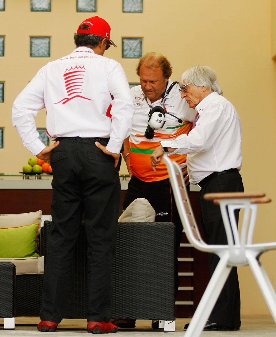 Force India deputy team principal Bob Fernley talks to Bernie Ecclestone and Bahrain International Circuit chairman Zayed Al-Zayani in the paddock