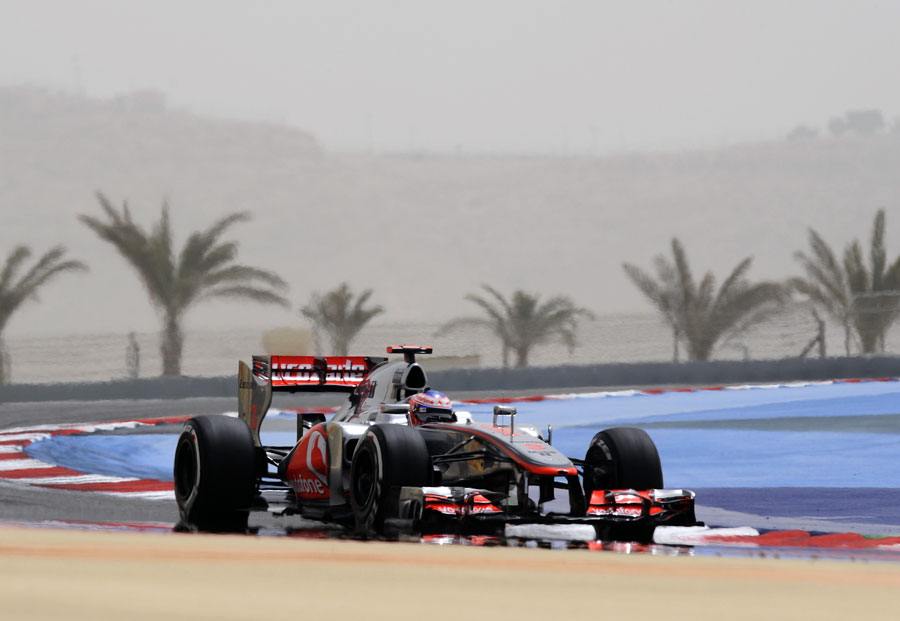 Jenson Button on track in the McLaren MP4-27 during Friday practice