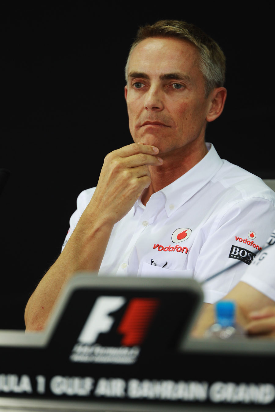 Martin Whitmarsh stares in to the middle distance during the FIA press conference on Friday