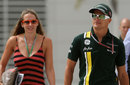 Heikki Kovalainen arrives in the paddock with his girlfriend Catherine Hyde