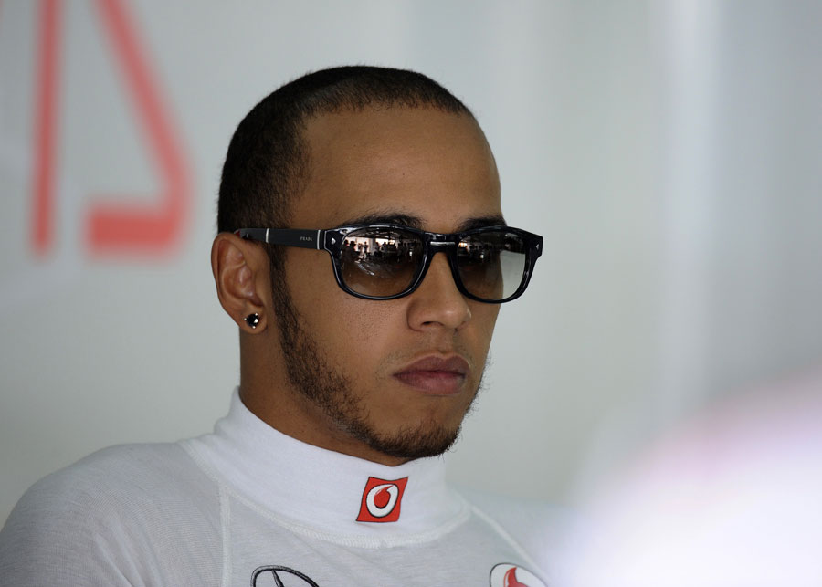 Lewis Hamilton relaxes at the back of the garage
