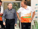 FIA president Jean Todt and Force India deputy team principal Bob Fernley walk into the paddock