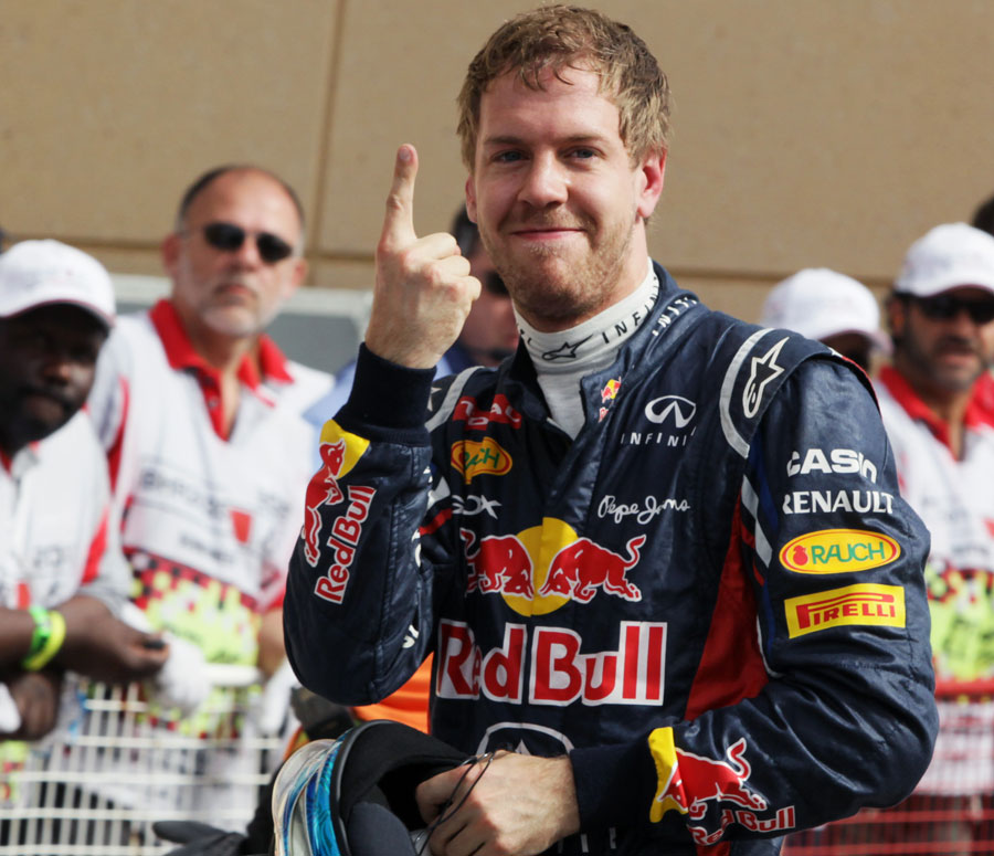 Sebastian Vettel celebrates his first pole position of the season