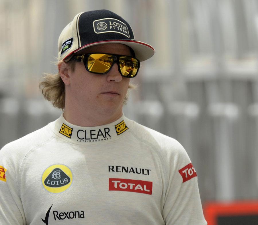 Kimi Raikkonen walks down the pit lane