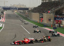 Kimi Raikkonen chases down Felipe Massa through the first corner