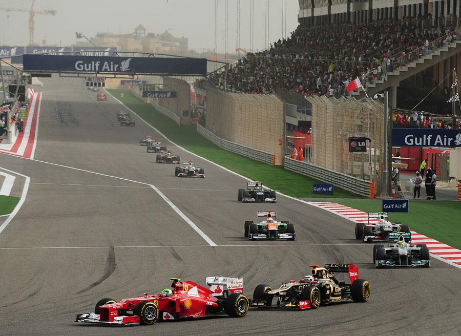 Kimi Raikkonen chases down Felipe Massa through the first corner