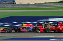 Mark Webber attempts to hold off Romain Grosjean and Fernando Alonso