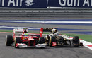 Kimi Raikkonen looks to the outside of Felipe Massa as he tries to find a way past