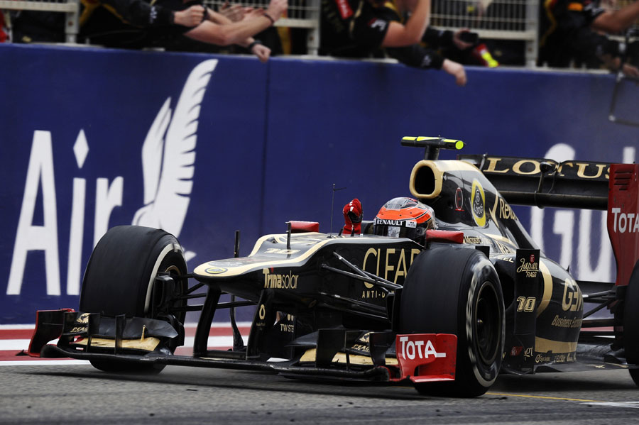 Romain Grosjean celebrates his third place as he crosses the line