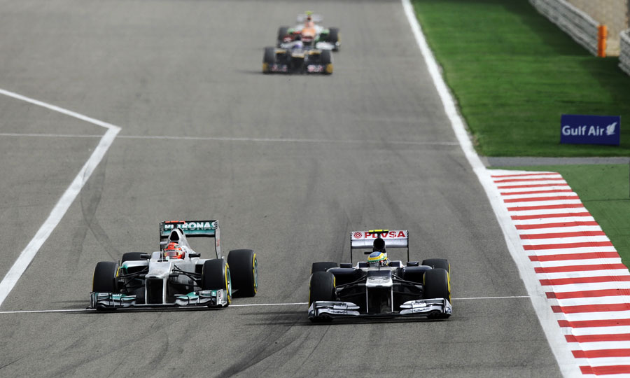 Michael Schumacher passes Bruno Senna into turn one