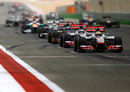 The McLarens line up on the dirty side of the grid