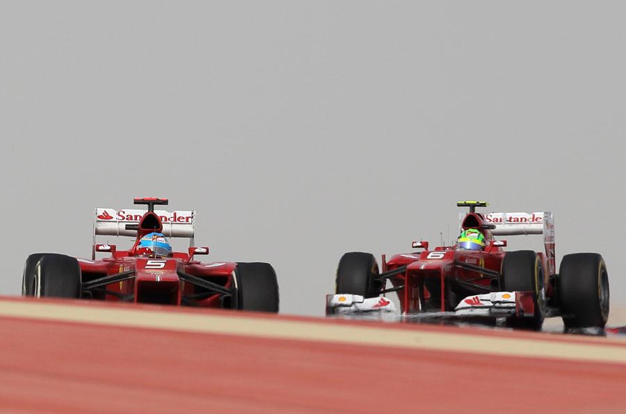Fernando Alonso leads Felipe Massa on track