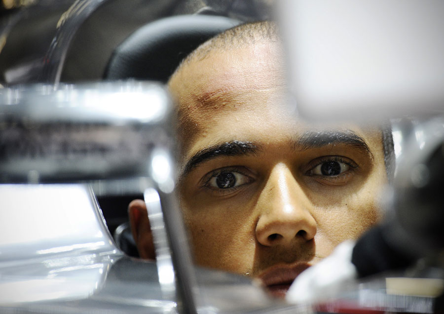Lewis Hamilton in the cockpit of his McLaren ahead of the session